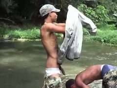 Dirty soldiers wash off cum in the river